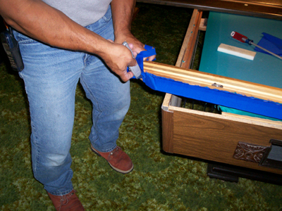 removing the excess felt from the pool table rails