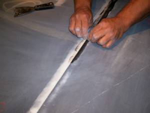 Scrape smooth with a single edge razor blade